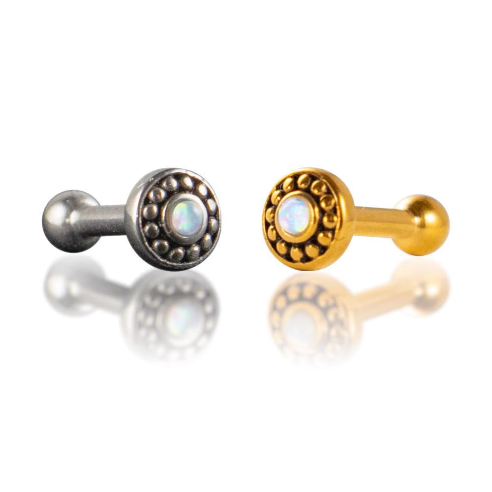 Barbell de acero quirúrgico 316L para piercings de la oreja. Diseño circular con una piedra de ópalo en el centro, y relieves de puntos de acero rodeándola. Disponible en plateado y dorado.