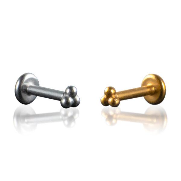 Labret de acero quirúrgico con forma de 3 bolitas. Disponible en plateado y dorado.